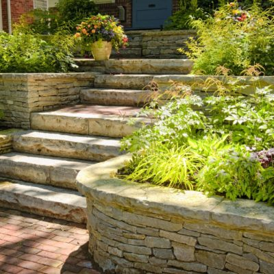 7608404 - natural stone landscaping in home garden with stairs